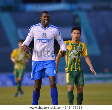 BANGKOK,THAILAND-AUGUST 10,2013:Mohamed Basir Savage (L) player of TOTSC in action during Thai Premier League 2013 between Army Utd and TOTSC at Army stadium on August 10, 2013 in Bangkok,Thailand