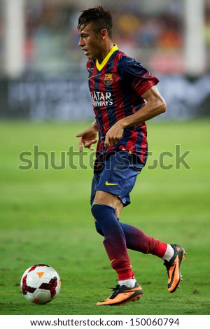 BANGKOK,THAILAND-AUGUST 07:Neymar JR of Barcelona run with the ball during the international friendly match between Thailand XI and FC Barcelona at Rajamangala Stadium on August 7,2013 in,Thailand. - stock photo