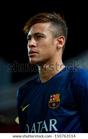 BANGKOK,THAILAND-AUGUST 07:Neymar JR (R) of FC Barcelona look on during the international friendly match Thailand XI and FC Barcelona at Rajamangala Stadium on August 7,2013 in,Thailand.