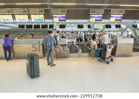 Bangkok,Thailand-August 31,2014 : Passengers arrive at check in desk  in Suvarnabhumi Airport  in Bangkok ,Thailand.This airport is handling about 45 million passengers annually. - stock photo