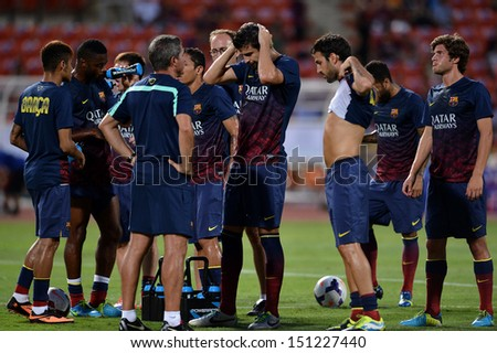 BANGKOK,THAILAND-AUGUST 7,2013:Players of FC Barcelona in action during the international friendly match Thailand XI and FC Barcelona at Rajamangala Stadium on August 7,2013 in,Thailand.