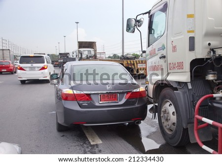 BANGKOK, THAILAND - AUGUST 21: Rescue forces in a deadly car accident scene on August 2014. Road accident new coupe gray hit the truck car kiss bottom on the freeway in rush hour. - stock photo