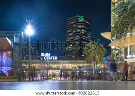 Bangkok, Thailand - August 3, 2015: Siam Center and Siam Paragon, the giant department stores located in the city center, in Twilight with the modern building and people coming for shopping.