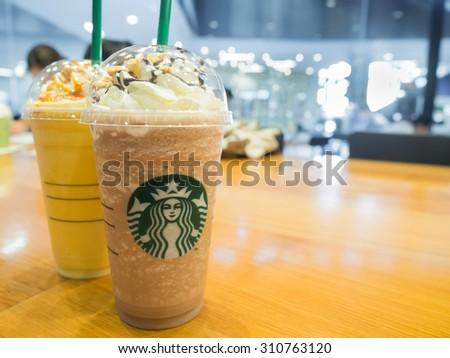 "Bangkok, Thailand  August 28, 2015: Starbuck in Thailand launch new menus, ""Mocha Honeycomb Frappuccino"" and ""Orange Honeycomb Crunch"".  - stock photo"