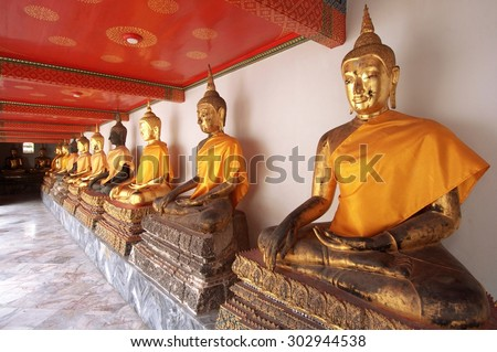 BANGKOK, THAILAND - August 1 : Statue of Buddha wearing in yellow sacred fabric clothing called the robe of Buddhist Monk at Wat Pho Bangkok, Thailand on August 1, 2015