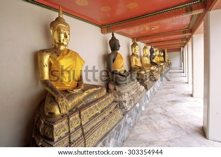 BANGKOK, THAILAND - August 1 : Statue of Buddha wearing in yellow sacred fabric clothing called the robe of Buddhist Monk at Wat Pho Bangkok, Thailand on August 1, 2015 - stock photo