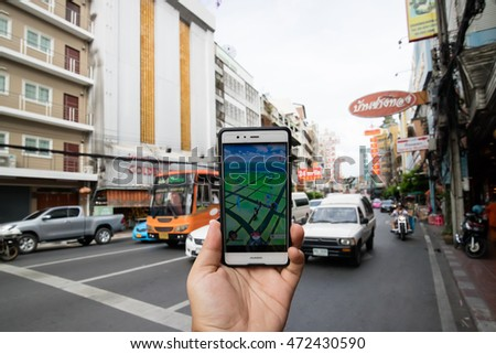 "BANGKOK,THAILAND - AUGUST 12, 2016: The hit augmented reality smartphone app ""Pokemon GO"" shows the game map based on real-world landmarks around the player's location. At Chinatown Yaowarat,Thailand."