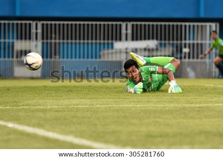 BANGKOK THAILAND- AUGUST 9:Tossaporn Srirueng of BEC-Tero Sasana FC in action during Thai Premier League between Thai Port Fc and BEC-Tero Sasana FC at PAT Stadium on August 9,2015 in Bangkok Thailand