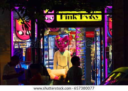 BANGKOK, THAILAND - AUGUST 25, 2016: Tourists and locals on the noisy and crowded night street in downtown of Bangkok.