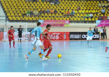 BANGKOK THAILAND - AUGUST 24 : Unidentified player in Friendly futsal match Between Thailand VS Spain at Nimibutr Stadium on August 24, 2012 in Bangkok,Thailand. - stock photo