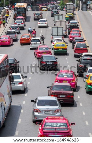 BANGKOK, THAILAND - AUGUST 06, 2013: Very bad traffic in the center of Bangkok city. The number of vehicle in Bangkok rose to 7.5 million but the city can only accommodate 1.6 million vehicles.