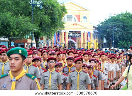 BANGKOK THAILAND - DEC 5 : An unidentified Boy scout parade during the celebration of the 87th birthday of H.M. King Bhumibol Adulyadej in Bangkok, Thailand on December 5, 2014. - stock photo