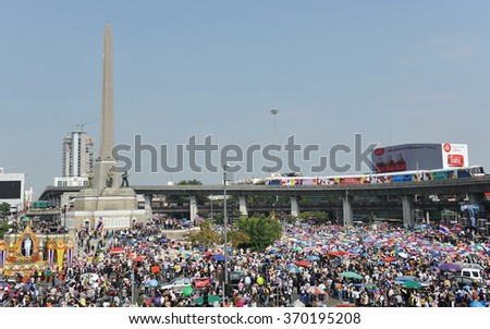 BANGKOK, THAILAND - DEC 21, 2013: Anti government protesters rally at the Thai capital's landmark Victory Monument. The protesters call for the government to be overthrown in a coup.