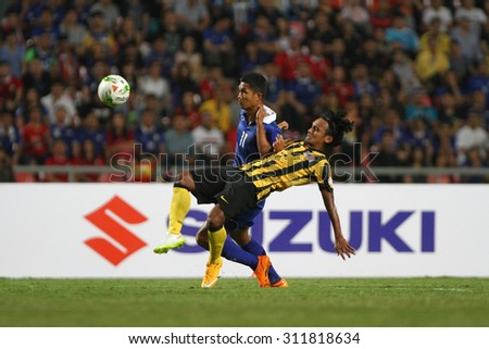 BANGKOK THAILAND DEC17::Mongkol Tossakrai(L)  of Thailand in action during the AFF Suzuki Cup 2014 Match between Thailand and Malaysia at Rajamangala Stadium on December 17,2014 in Thailand.