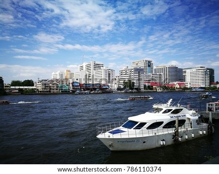 Bangkok, Thailand Dec 17, 2017:  tourists transport by A long-tail boaton the Chao Praya River. Long-tail boats are a famous and popular in tourism ride along Chao Praya River.