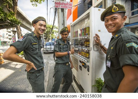 BANGKOK, THAILAND - DEC 17, 2014: Unidentified young Thai soldiers on a street in the city center. Military service runs on a contract (65%) and mandatory system. Draft age - 20-55 years.  - stock photo