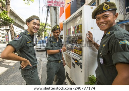 BANGKOK, THAILAND - DEC 17, 2014: Unidentified young Thai soldiers posing for the camera on a street in the city center. - stock photo
