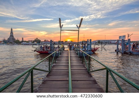 BANGKOK, THAILAND - DEC 18, 2015: View of Wat Arun over Chao Phraya River at Sunset in Bangkok, Thailand. Wat Arun is a Buddhist temple on the Thonburi west bank of the Chao Phraya River.
