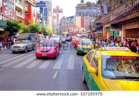 BANGKOK, THAILAND - DEC 9:Yaowarat Road,the main street in Chinatown, built by King Rama V.This crowded street winds through the bustling heart of Chinatown on December 9, 2011 in Bangkok, Thailand. - stock photo
