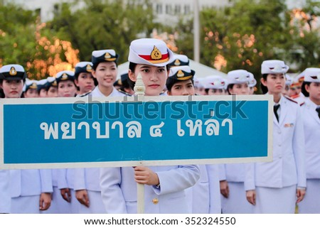 BANGKOK, THAILAND - DECEMBER 5: Army nurse, Agent of military nursing students of Army, Navy, Air Force, and Police holds sign in in father's day parade on December 5, 2015, in Bangkok, Thailand - stock photo