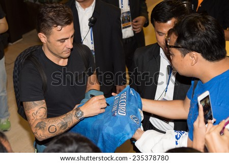 BANGKOK, THAILAND - DECEMBER 03: Fabio Cannavaro signs autographs for fans as he arrives in the lead up to the Global Legends Series, at the Swissotel, on Dec 3, 2014 in Bangkok, Thailand - stock photo