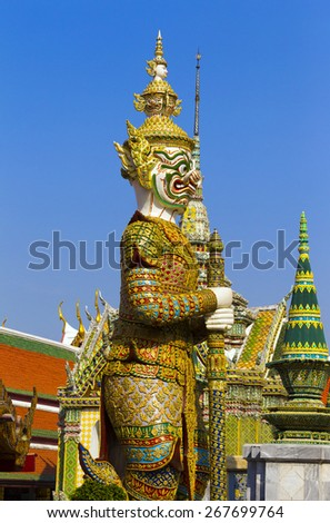 BANGKOK, THAILAND - DECEMBER 27 : Giant in Wat Phra Kaew, Temple of the Emerald Buddha and the home of the Thai King  on December 27, 2013 in Bangkok, Thailand.  - stock photo