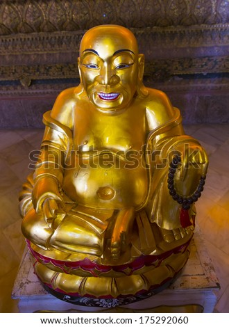 BANGKOK, THAILAND - DECEMBER 27 : Golden statue at Wat Pho temple on December 27, 2013 in Bangkok, Thailand. Wat Pho is home to more than one thousand Buddha images.