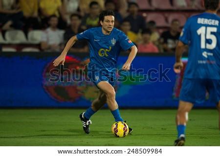 BANGKOK,THAILAND-DECEMBER 05: Jari Litmanen of Team Cannavaro runs with the ball against Team Figo during the Global Legends Series match, at the SCG Stadium on December 5, 2014 in Bangkok, Thailand. - stock photo