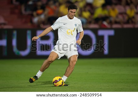 BANGKOK,THAILAND-DECEMBER 05: Javier Zanetti of Team Figo runs with the ball against Team Cannavaro during the Global Legends Series match, at the SCG Stadium on December 5, 2014 in Bangkok, Thailand. - stock photo