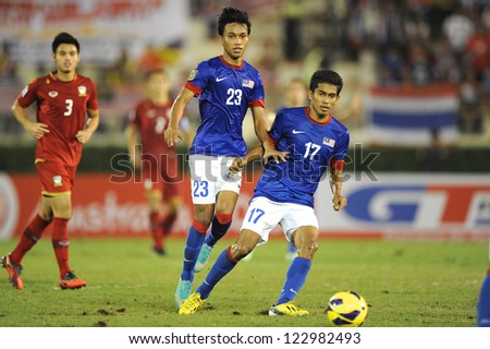 BANGKOK THAILAND-DECEMBER 13:Mohd Azamuddin Md Akil #17of Malaysia(blue) in action during the AFF Suzuki Cup between  Malaysia and Thailand at Supachalasai  stadium on Dec13, 2012 in Bangkok,Thailand.