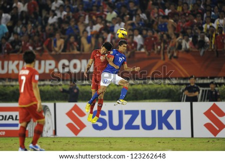 BANGKOK THAILAND-DECEMBER 13:Mohd Azamuddin Md Akil of Malaysia (blue) in action during the AFF Suzuki Cup between Malaysia and Thailand at Supachalasai stadium on Dec13, 2012 in,Thailand.