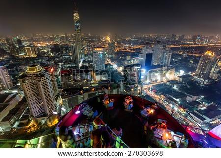 BANGKOk, THAILAND, DECEMBER 25, 2014: Night Bangkok skyline view from the Centara hotel rooftop in Central World district, Bangkok, Thailand - stock photo