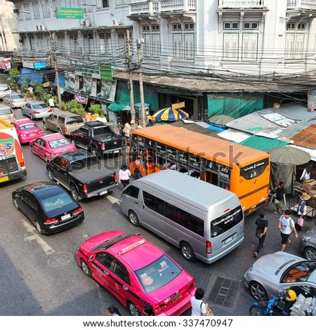 BANGKOK, THAILAND - DECEMBER 7, 2013: People drive in traffic jam in Bangkok. Bangkok is the biggest city in Thailand with 14 million people living in its urban area.