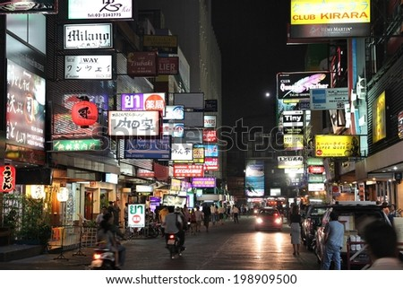 BANGKOK, THAILAND - DECEMBER 21, 2013: People visit Patpong in Bangkok. Patpong is the Bangkok's entertainment district. Bangkok is Thailand's capital city, 8.3 million people live here.