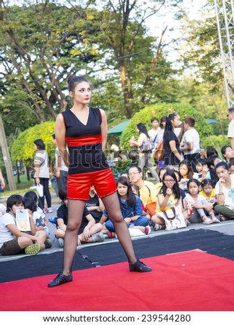 BANGKOK, THAILAND - DECEMBER 14, 2014: Performer poses her gesture in Bangkok street show 2014, hold in Lumpini Park, Bangkok , Thailand - stock photo