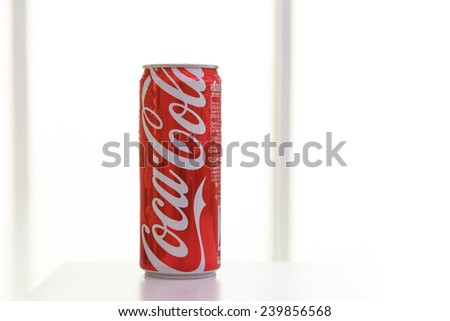 BANGKOK, THAILAND - December 25, 2014: Photo of long can of Coca-Cola. Coca-cola is the World's most selling carbonated soft drink. - stock photo