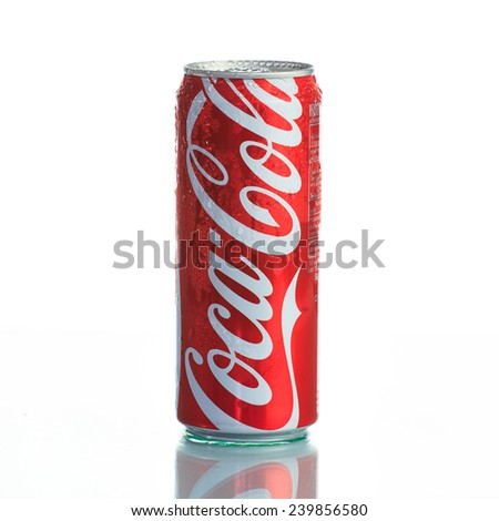 BANGKOK, THAILAND - December 25, 2014: Photo of long can of Coca-Cola on white background. Coca-cola is the World's most selling carbonated soft drink. - stock photo