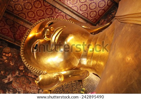 BANGKOK -THAILAND - DECEMBER 30 : Reclining Buddha statue in Temple of Wat Pho, asian style on December 30, 2014 in Bangkok, Thailand