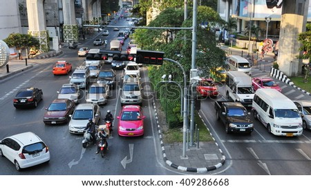 Bangkok, Thailand - December 22, 2010: Rush hour traffic moves slowly along a busy city centre road. Annually an estimated 150,000 new cars join the already heavily congested streets of Bangkok.
