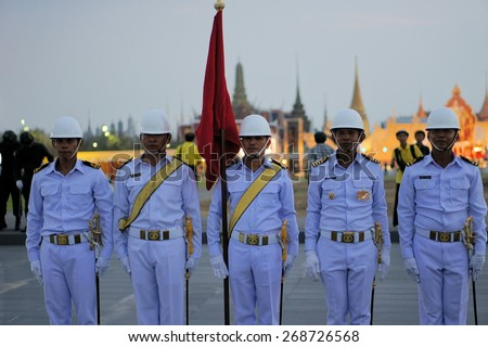 Bangkok, Thailand - 5 December 2014: Soldiers perform a military parade, showcasing Thailand's strength to celebrate the 87th birthday of His Majesty King Bhumibol Adulyadej at the royal field Sanam - stock photo