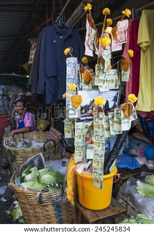 """BANGKOK, THAILAND - DECEMBER 25, 2014: Street Photography of Street market in China town.  """"Money Tree"""" - a symbol of successful trading. - stock photo"""