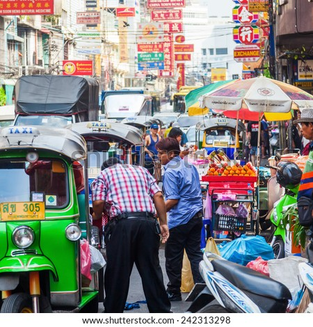 BANGKOK, THAILAND - DECEMBER 12, 2014: street scene in Chinatown with unidentified people. Chinese began settling in the Bangkoks Chinatown circa 1800s, it is a famous tourist attraction - stock photo
