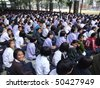 BANGKOK, THAILAND - DECEMBER 20 : Students sit outside for morning assembly at Seekan school December 20, 2005 in Bangkok. - stock photo