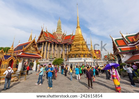 BANGKOK, THAILAND - DECEMBER 16, 2014: temple Wat Phra Kaew with unidentified people. Wat Phra Kaew or Wat of the Emerald Buddha is regarded as the most sacred Buddhist temple in Thailand - stock photo
