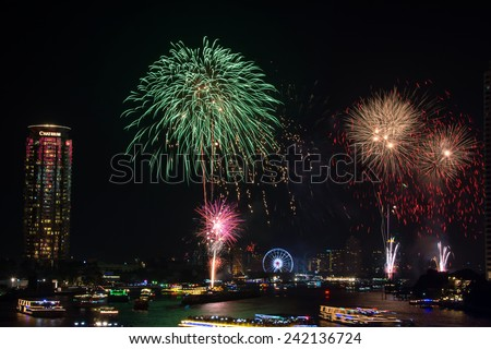 Bangkok,Thailand - December 31,2014 : The happy new year 2015 exploding fireworks over chaophraya river  in Bangkok,Thailand.