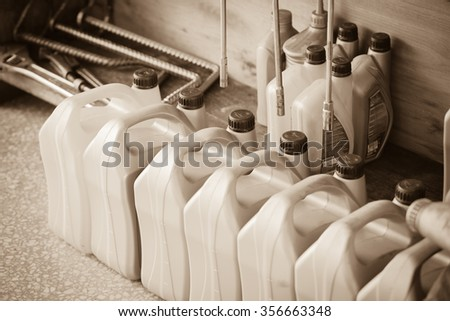 BANGKOK, THAILAND - DECEMBER 28 : The plastic oil containers and tools in garage on December 28, 2015 in Bangkok, Thailand