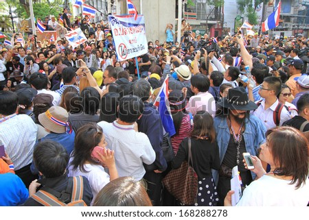 BANGKOK,THAILAND- DECEMBER 20 : The protesters, led by the PDRC secretary-general Suthep Thaugsuban march from Ratchadamnoen Avenue to Silom Rd. on December 20,2013 in Bangkok,Thailand.