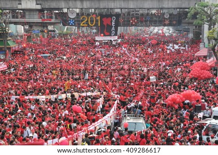 Bangkok, Thailand - December 19, 2010: Thousands of anti government Red Shirt protesters defy an emergency decree to protest at Ratchaprasong Junction in the city centre.