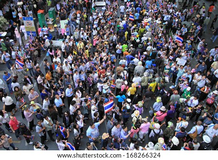 BANGKOK,THAILAND- DECEMBER 20 : Thousands of protesters walked for anti government corruption at Silom Rd. on December 20,2013 in Bangkok,Thailand.