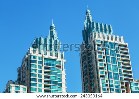 BANGKOK, THAILAND - DECEMBER 11, 2014: twin towers in the city of Bangkok. Bangkok is one of the most important economic and transport centres in South-East Asia - stock photo